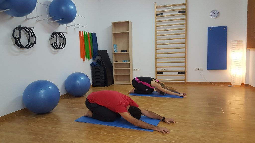 How To Tackle Back Pain By Doing Pilates